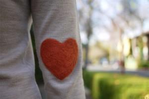 Kaip užlopyti megztinį